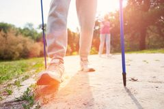 Close up of elderly people using walking canes stock images
