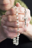Close-Up Of Elderly Person Holding Rosary Beads.  royalty free stock photos