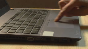 Close up of elderly woman hands using laptop at home. Close up stock video