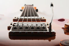 Close up of electic guitar bridge and neck. Close up of electric guitar bridge in colors with whammy bar Royalty Free Stock Images