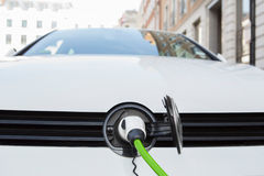 Close Up Of Electric Car Being Charged Royalty Free Stock Image