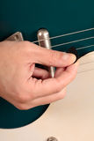 Close up of an electric guitar being played Stock Images