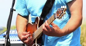 Playing the electric guitar outside royalty free stock images