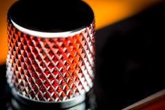 Close up of a electric guitar knob. Macro Close up of a electric guitar knob with diamond pattern on it Royalty Free Stock Photos