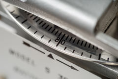 Close-up of electric meter measuring dial. Royalty Free Stock Photos
