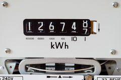 Close-up of electric meter. Electric meter showing reading number display, kilowatt hour symbol and measuring dial Stock Photo