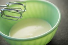 Close up of electric mixer by bowl with batter Stock Images