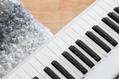 Close-up of electric piano and chair Stock Photo