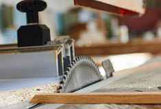 Close up electric saw to sawing wood board, solf focus. Close up electric saw to sawing wood board. Selective focus Royalty Free Stock Photography