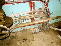 Soviet water treatment plant. Close up electric wires, very confused interior of soviet water treatment plant. interior of abandoned factory buildings. old large royalty free stock images