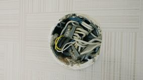 Close-up electrical junction box on the wall under the ceiling.  stock video