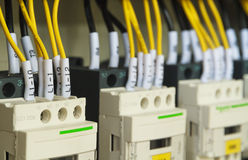 Close-up electrical wiring with fuses and contactors. Stock Images