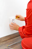 Close up of electrician hands fixing socket Royalty Free Stock Photography