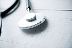 Electrocardiogram and stethoscope. Close up of an electrocardiogram in paper form and a stethoscope stock images