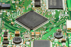 Close up of electronic circuit board with microchip. And components Stock Images