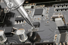Close up of electronic circuit board with several semiconductors Royalty Free Stock Photography