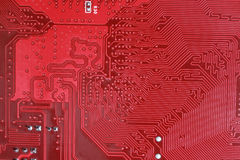 Close-up of electronic circuit red board background. Close up of electronic circuit red board background Royalty Free Stock Photography