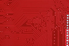 Close-up of electronic circuit red board background Royalty Free Stock Images