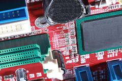 Close-up of electronic circuit red board with processor of compu Royalty Free Stock Photo