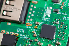 Close up of electronic components on the motherboard, microprocessor chip. Close up of electronic components on the motherboard microprocessor chip Stock Photo