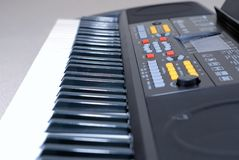 Close up of electronic keyboard synthesizer. Musical instrument electronic keyboard piano close up. Selective focus on black keys and some buttons on keboard Royalty Free Stock Photography