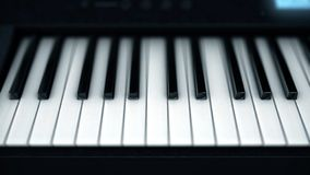 Close-up of electronic piano keys. Smart feed on abstract keys of glowing electronic piano. Musical instruments royalty free stock photo