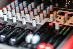 Close up electronic professional sound mixer control panel in mu Royalty Free Stock Image