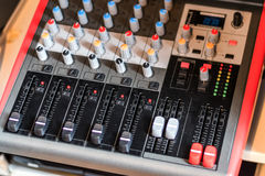 Close up electronic professional sound mixer control panel in mu Royalty Free Stock Photo