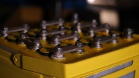 Close-up of electronic yellow box. Rotating electronic box for protection or distribution of electricity with levers for. Connecting cables stock video