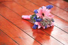 Close up elegance blue and pink flowers bouquet on wood table Royalty Free Stock Image