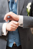 Close-up of elegance groom hands Stock Images