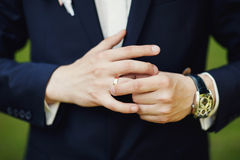 Close-up of elegance male hands. man dressed in blue suit and wh Royalty Free Stock Photos