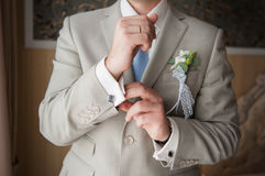 Close-up of elegance man hands with ring, necktie and cufflink Royalty Free Stock Photo