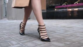 Close up of elegant female legs walking in street stock video footage