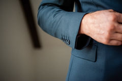 Close up of elegant man buttoning up Royalty Free Stock Photos