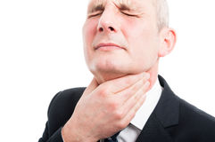 Close-up of elegant man holding his throat like hurting Stock Image