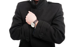 Close-up of  elegant man posing wearing overcoat. And watch isolated on white background Stock Photos