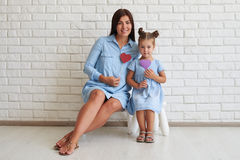 Close-up of elegant stylish mother and her daughter while sittin Stock Photography
