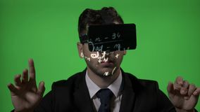 University scientist lecturer who uses virtual reality glasses to correct students mathematic formulas on green screen background. Close up of an elegant stock footage