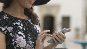 Close-up of elegant young female with nice manicure typing message on smartphone. Stock footage stock footage