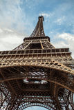 Close-up element part of Eiffel tower in Paris against dramatic twilight sky at evening summer time Stock Photography