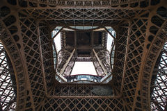 Close-up element part of Eiffel tower in Paris against dramatic twilight sky at evening summer time Royalty Free Stock Image