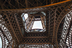 Close-up element part of Eiffel tower in Paris against dramatic twilight sky at evening summer time Stock Images