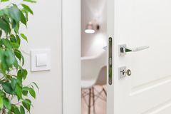 Close-up elements of the interior of the apartment. Ajar white door Stock Images