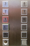 Close up on elevator buttons. Straight on close up view of twelve heavy duty square elevator buttons in stainless steel surface Stock Image