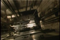 Close-up of elevator moving down elevator shaft stock footage