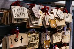 Close up Ema are small wooden plaques, common to Japan, in which Shinto and Buddhist worshippers write prayers or wishes. Close up Ema are small wooden plaques Royalty Free Stock Photography