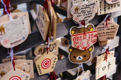Close up Ema are small wooden plaques, common to Japan, in which Shinto and Buddhist worshippers write prayers or wishes. Close up Ema are small wooden plaques Stock Photo
