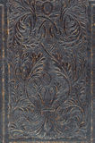 Close-up of embossed, distressed, vintage book cover. Royalty Free Stock Photos