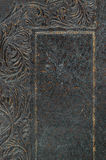 Close-up of embossed distressed vintage book cover. Royalty Free Stock Images